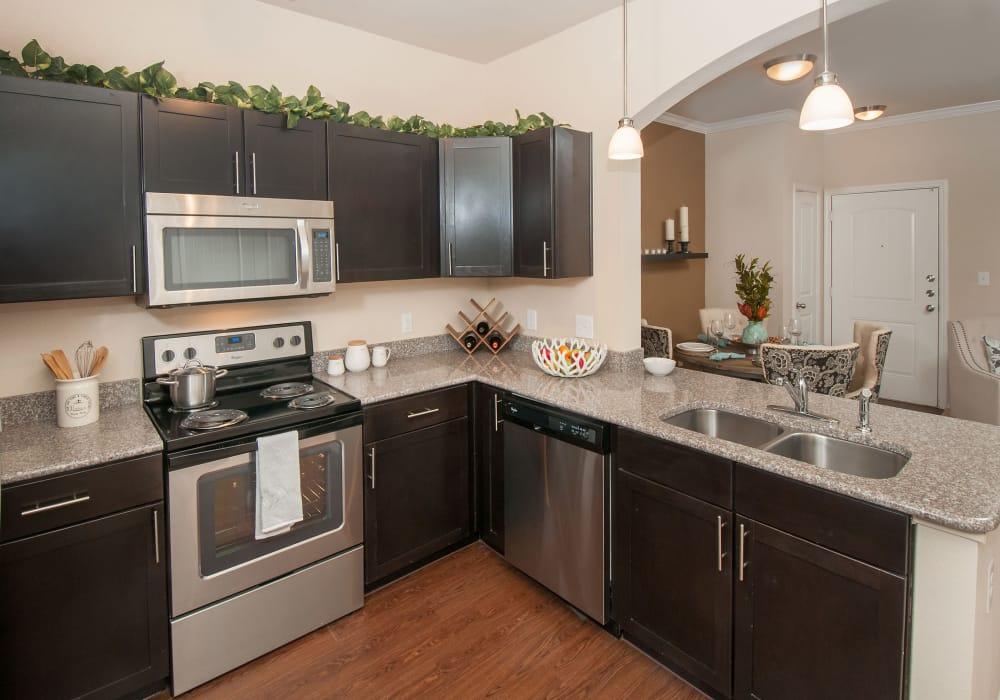 Carrington Oaks showcase a modern and furnitured kitchen in Buda, Texas