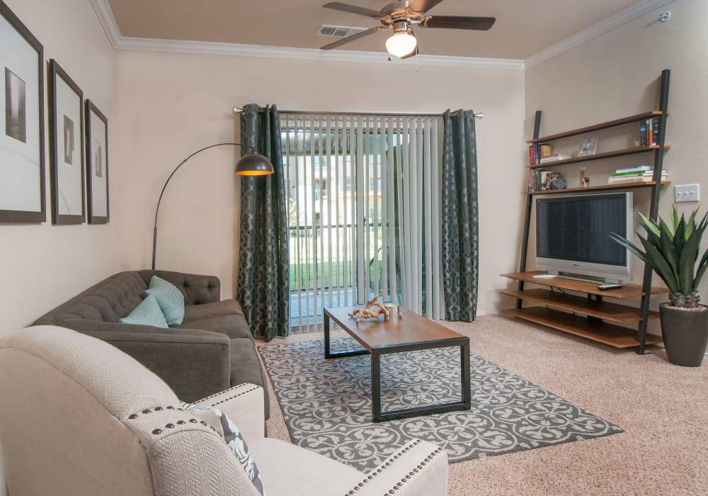 Enjoy a luxury living room with patio access at Carrington Oaks in Buda, Texas