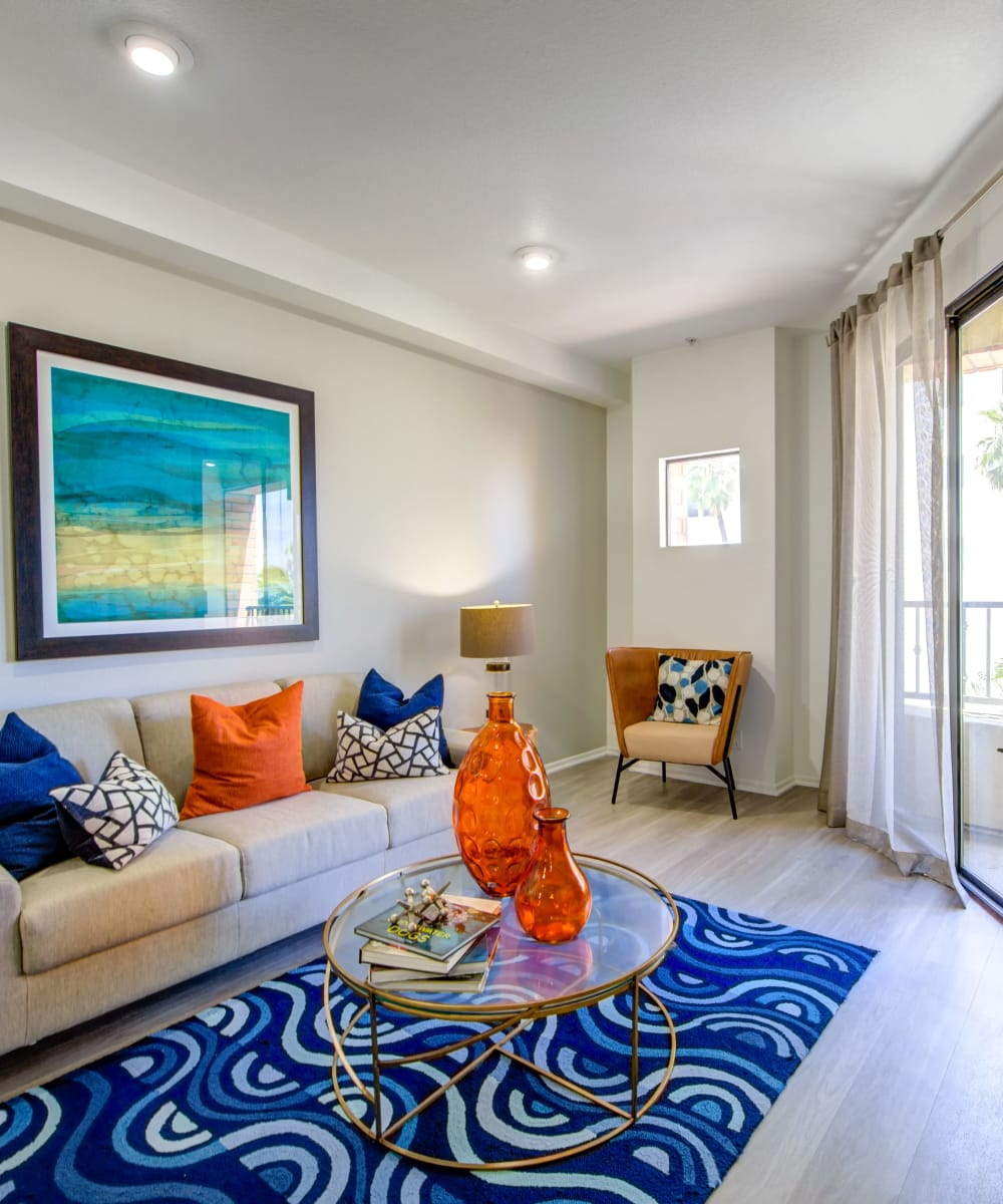 Well-decorated living area in a model home at Sofi at 3rd in Long Beach, California