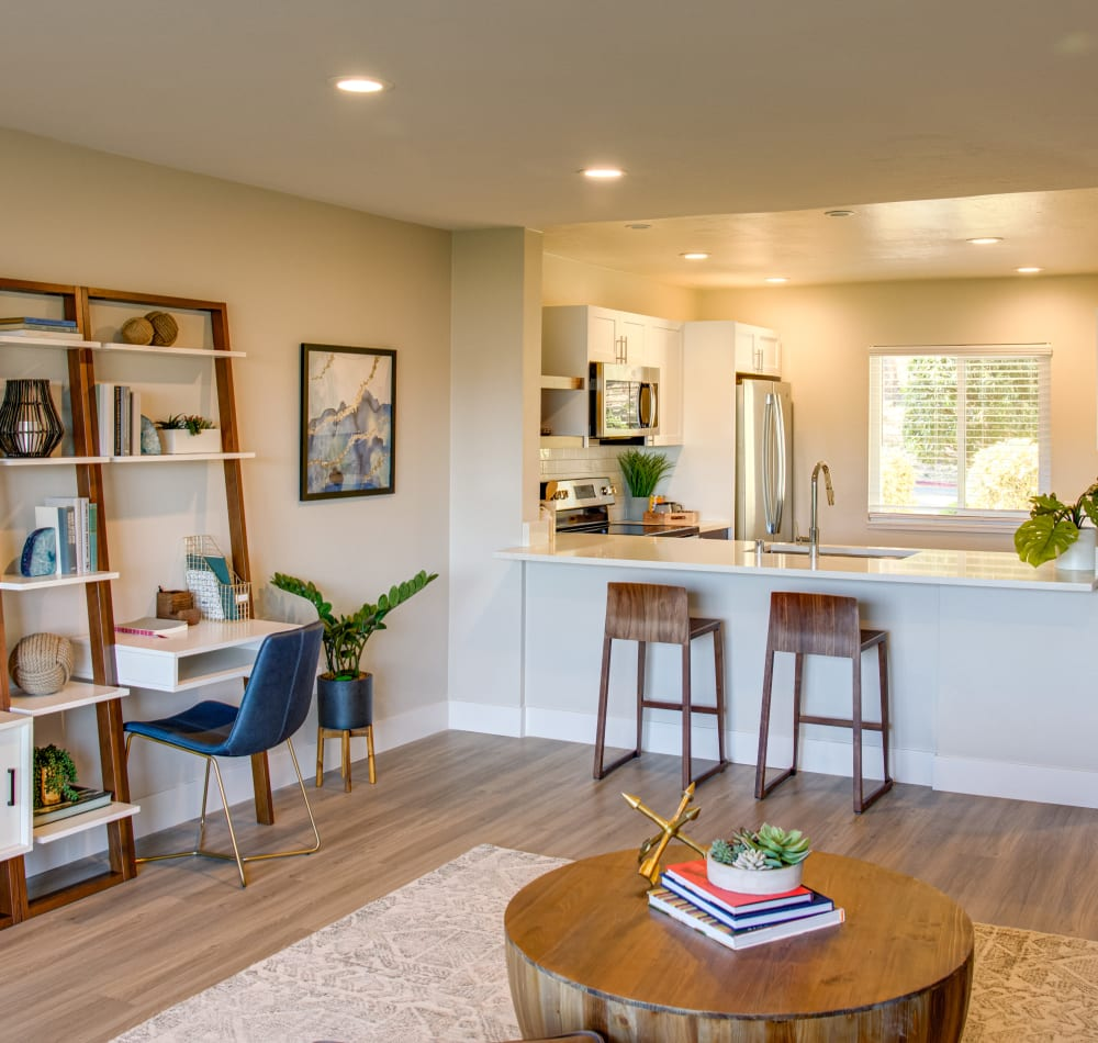 Open-concept layout with hardwood floors and modern decor in a model home at Harbor Point Apartments in Mill Valley, California