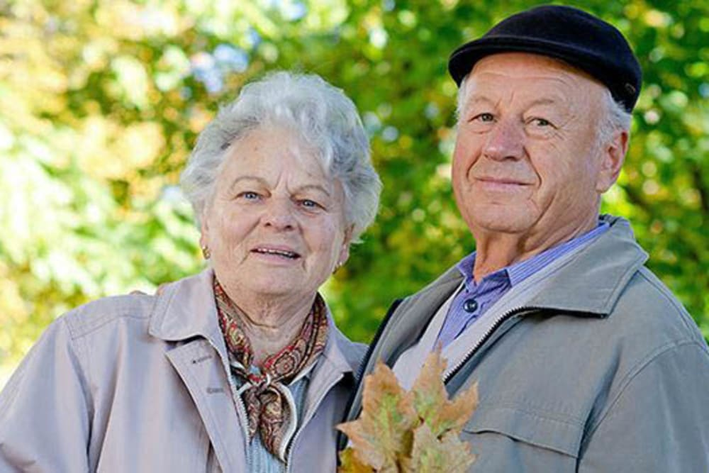 Happy couple outdoors at Peachtree Village Retirement Community