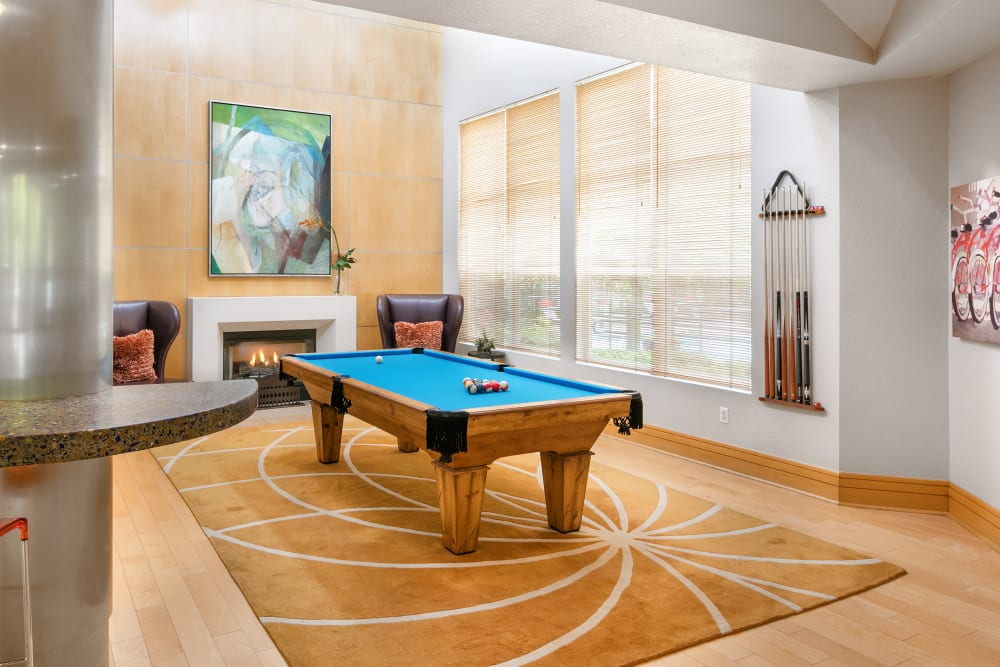Large clubhouse with a billiards table and comfortable seating at Center Pointe Apartment Homes in Beaverton, Oregon