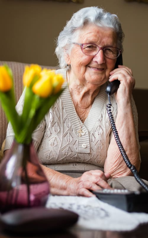 A resident making a phone call at Jaybird Senior Living