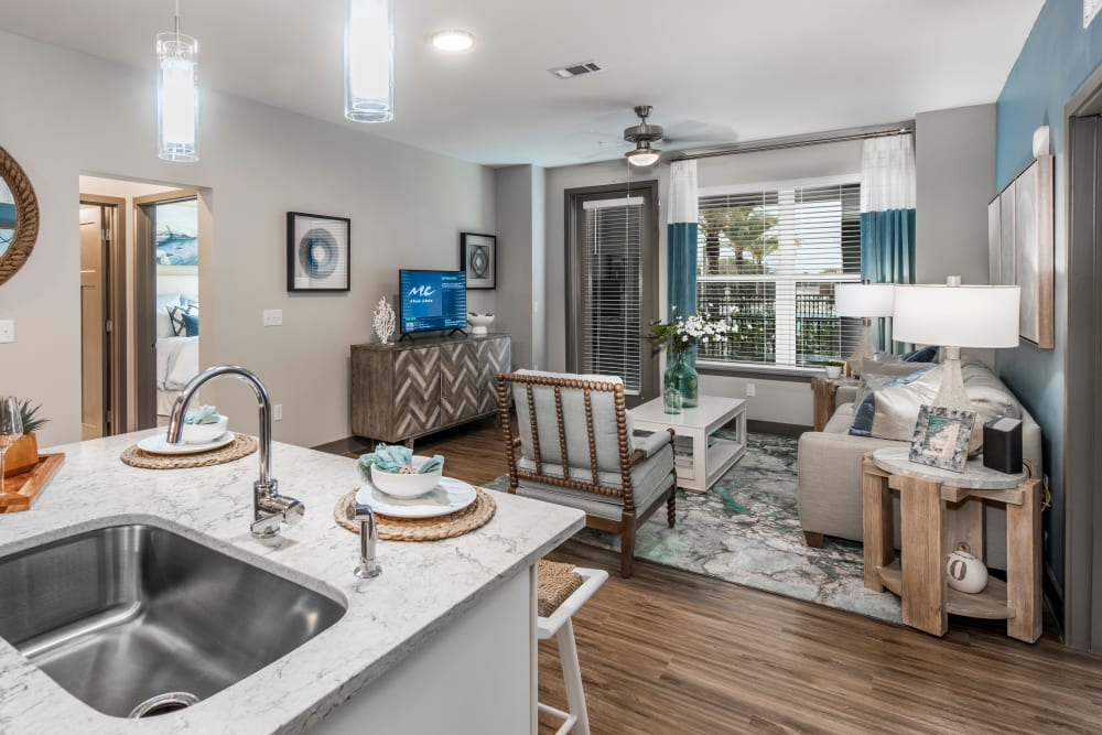 A large living room with a ceiling fan at Olympus Emerald Coast in Destin, Florida