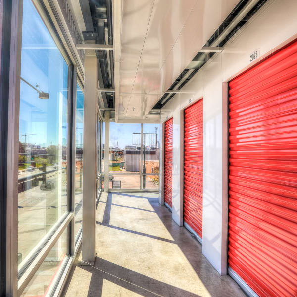 Interior units with bright doors at StorQuest Self Storage in Denver, Colorado