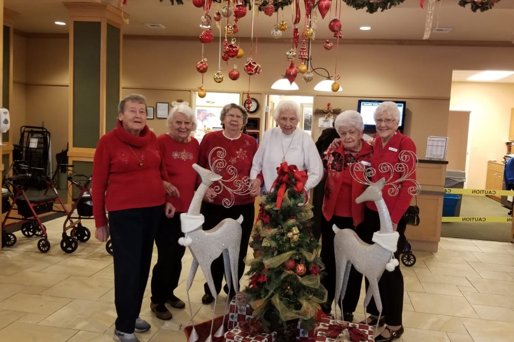 Resident friends celebrating the holidays at Merrill Gardens at Renton Centre in Renton, Washington.