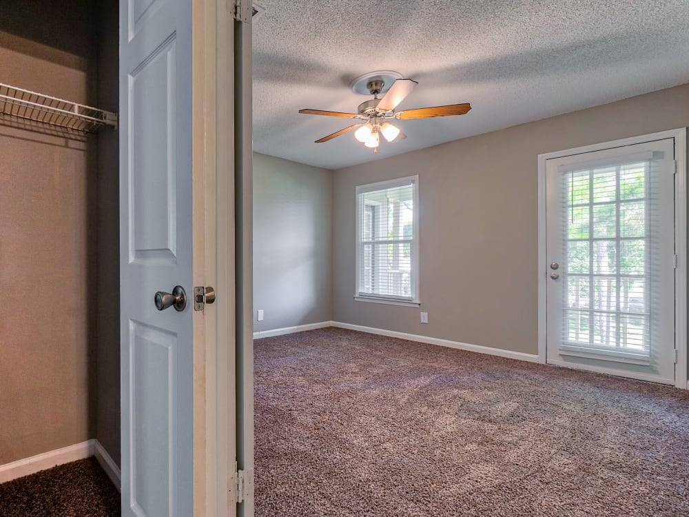closet and bedroom at The Gatsby at Midtown Apartment Living in Montgomery, AL