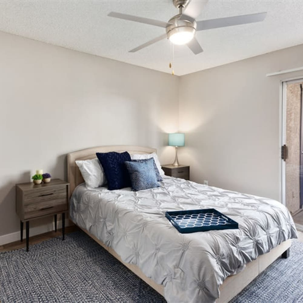 A bedroom with a ceiling fan at 1408 Casitas at Palm Valley in Avondale, Arizona