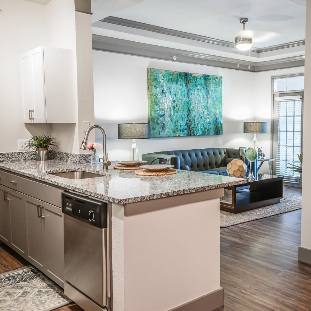 Open concept kitchen with wood flooring at Beck at Wells Branch in Austin, Texas
