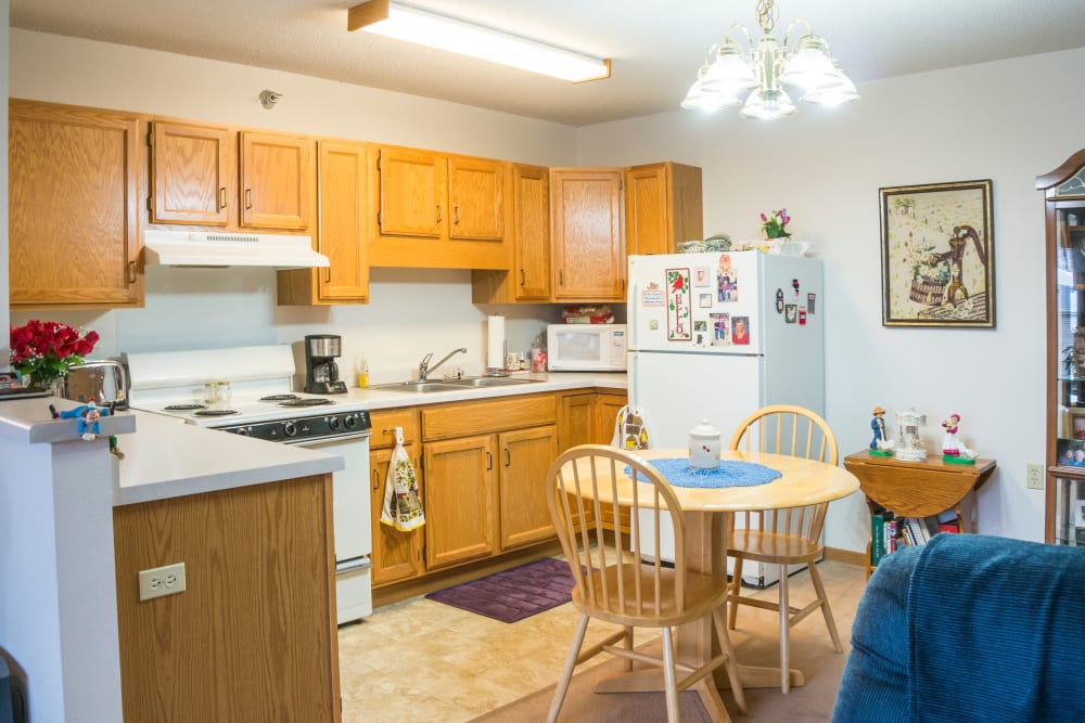 Open floor plans with a full kitchen at Meadow Lakes Senior Living in Rochester, Minnesota.