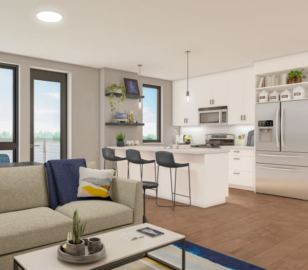 A rendering of a living room and kitchen of The Columbia at the Waterfront in Vancouver, Washington