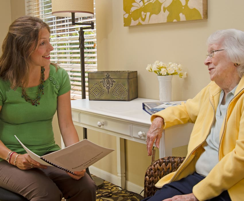 A resident talking to a staff member at Carefield Living.