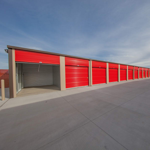 Outdoor storage units with red doors at StorQuest Express Self Service Storage in Phoenix, Arizona