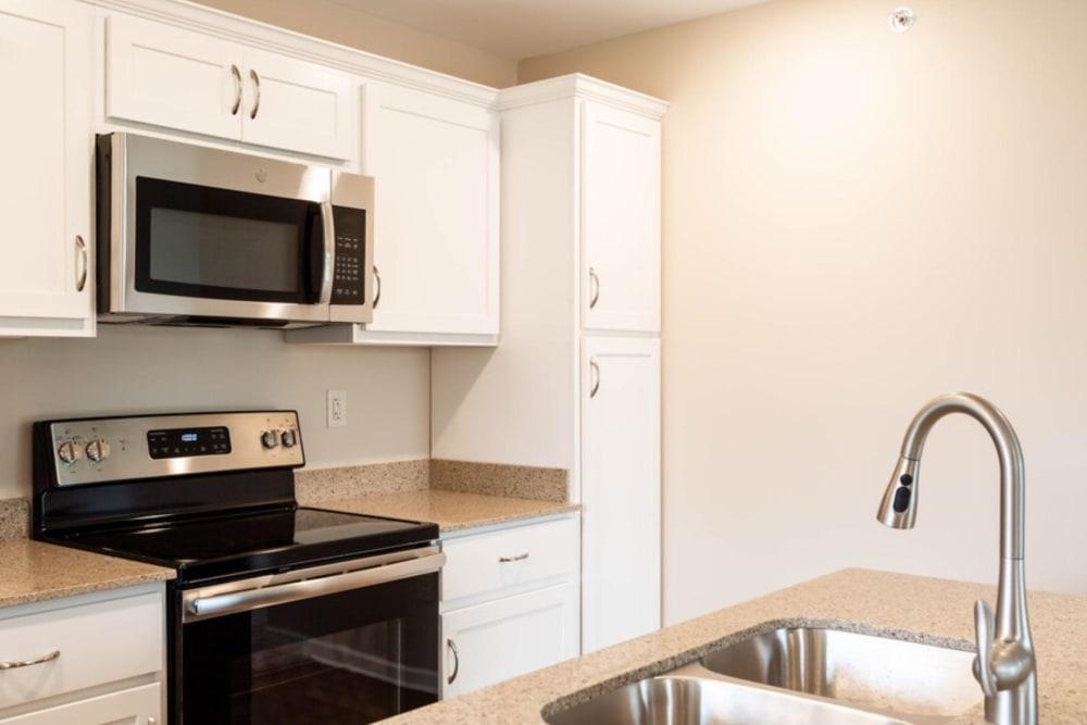Kitchen with stainless-steel sink at Bennington Hills Apartments in West Henrietta, New York