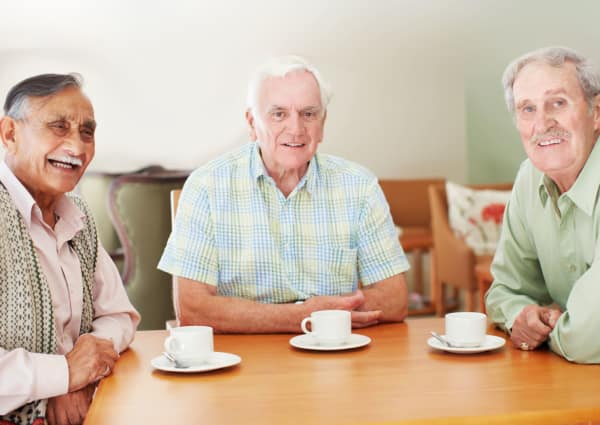 Residents gathered for coffee at Mill Creek Village Senior Living in Columbia, Missouri