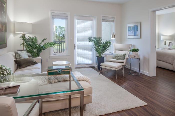 Lovely well-lit model living room at All Seasons Naples in Naples, Florida