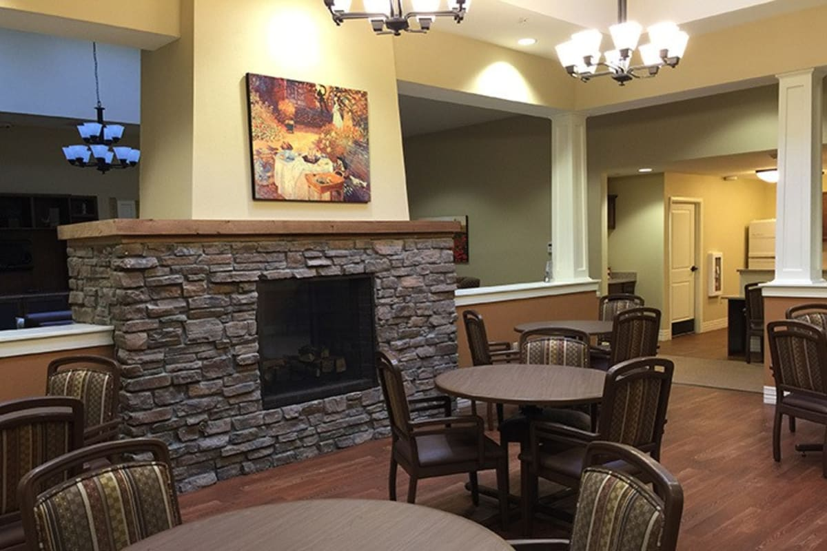 Dining area with fireplace at New Dawn Memory Care in Colorado Springs, Colorado