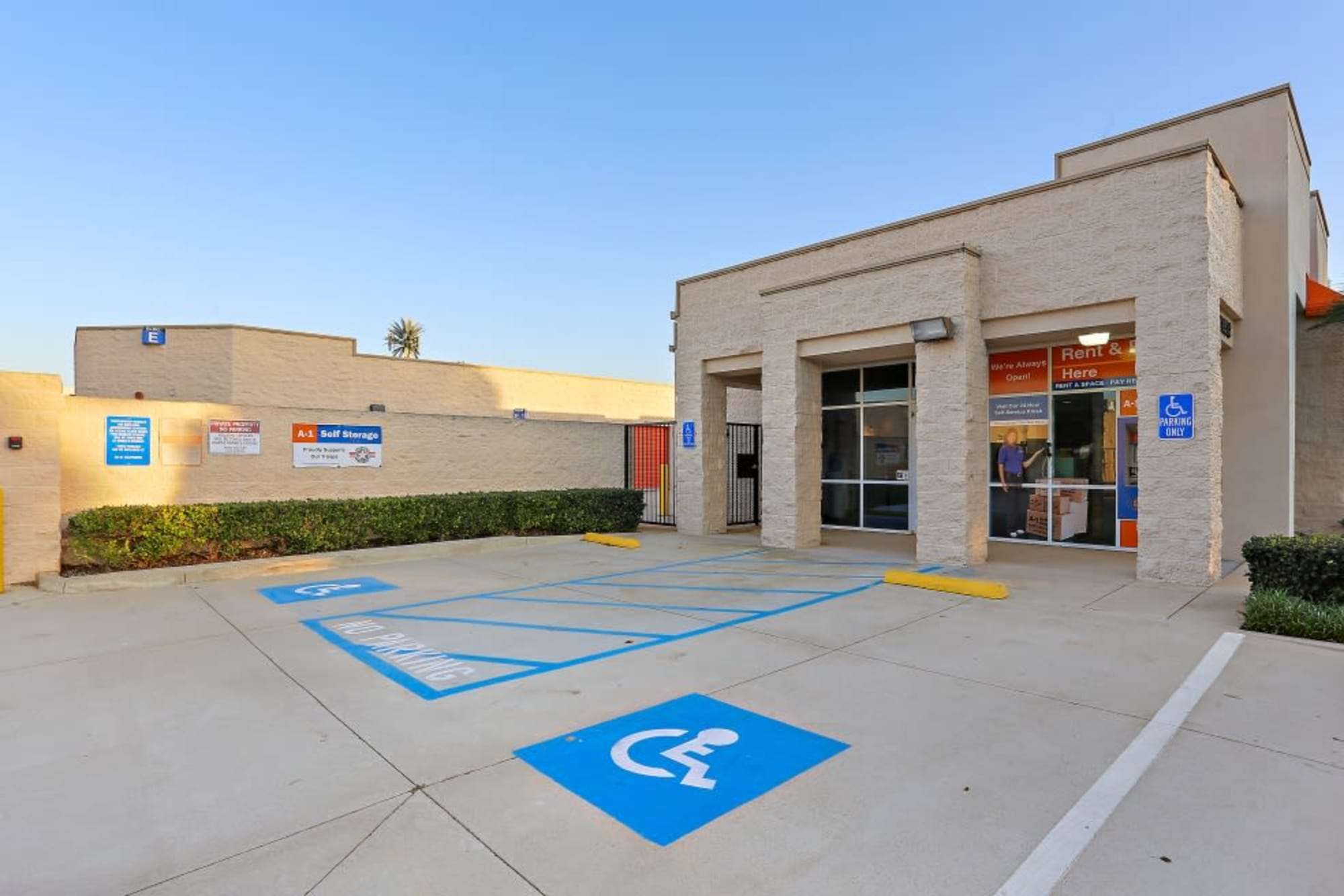 Handicap parking spots and the front entry to A-1 Self Storage in Huntington Beach, California