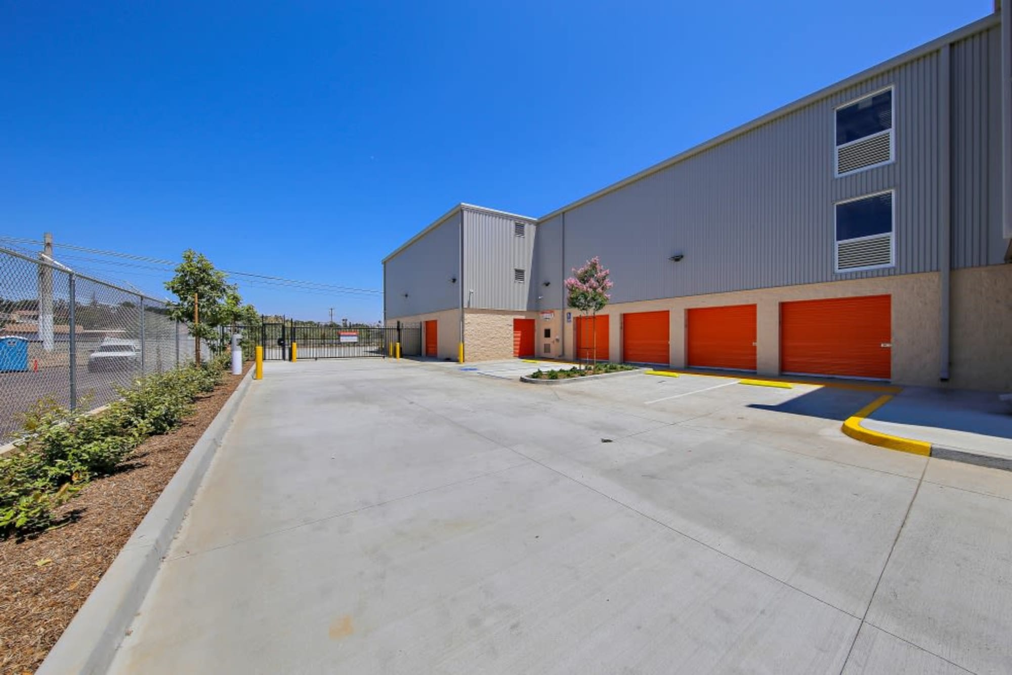 Exterior units and a wide driveway at A-1 Self Storage in San Diego, California