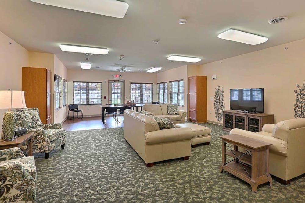 Spacious resident TV room at Milestone Senior Living in Tomahawk, Wisconsin.
