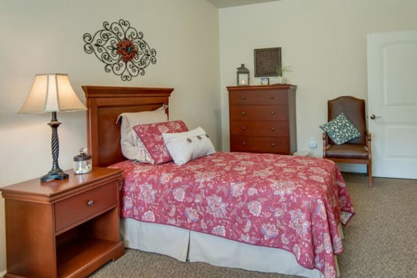 Assisted living apartment bedroom at Mattis Pointe Senior Living in Saint Louis, Missouri