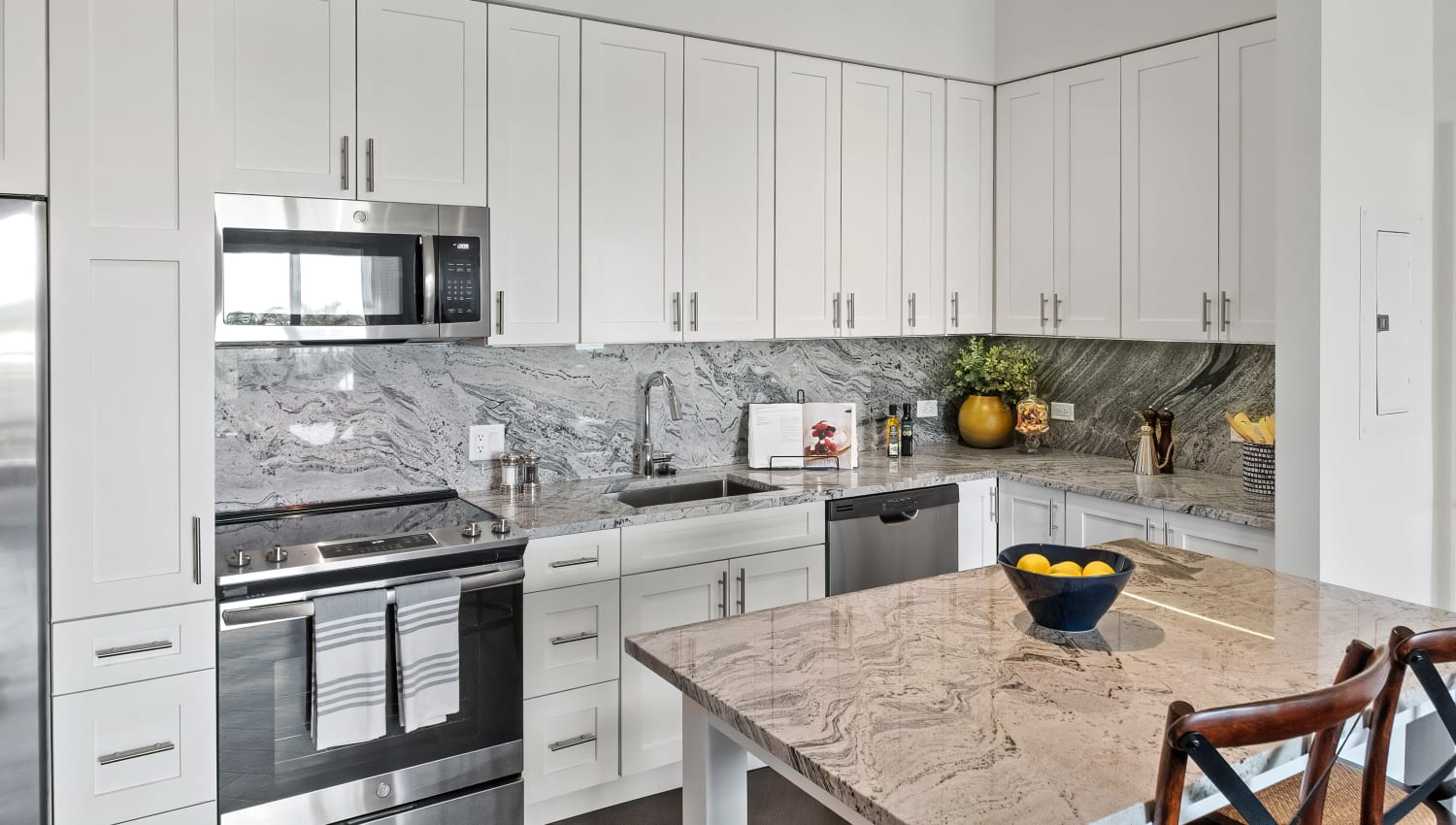 Beautiful model kitchen with adaptable island and stainless steel appliances at Town Lantana in Lantana, Florida
