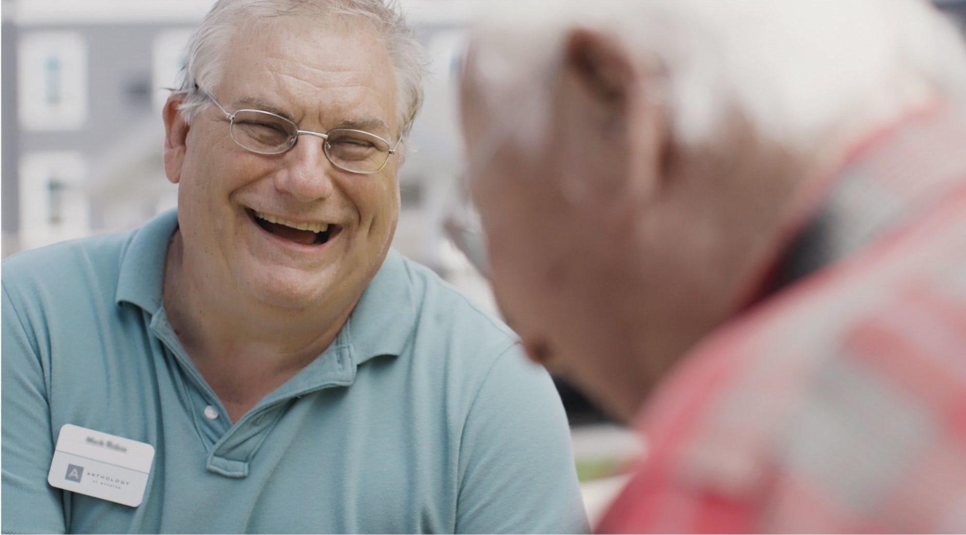 Residents laughing together at a Anthology Senior Living community
