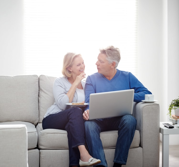 Couple enjoying laptop time at Waterway Court Apartments in Point Pleasant, New Jersey