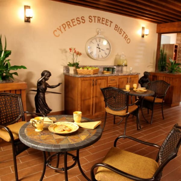 Restaurant style dining room at Quail Park Memory Care Residences of Visalia in Visalia, California