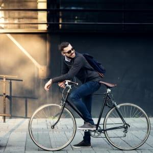 Resident biking in town near K Street Flats Apartment Homes in Berkeley, California