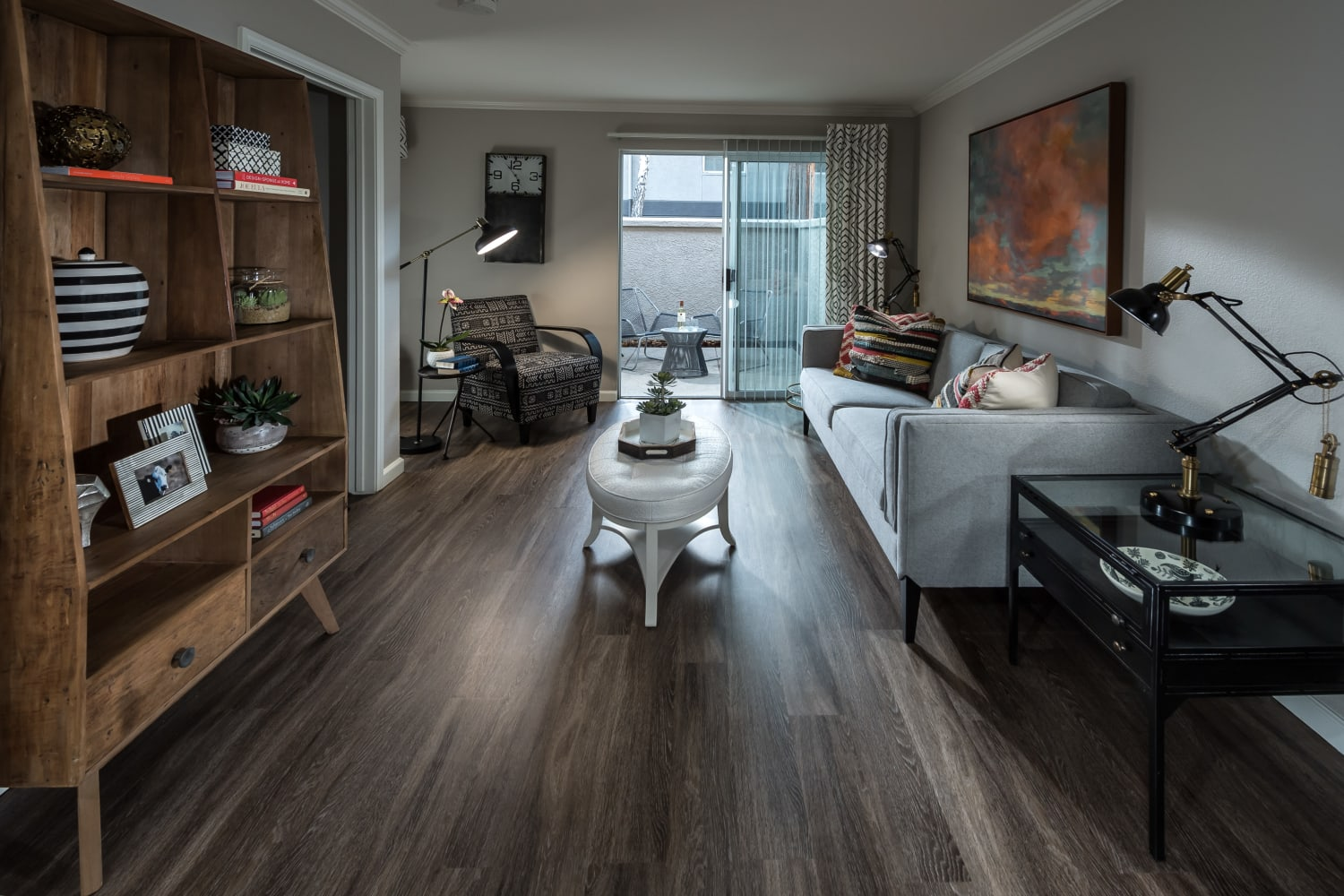 Modern living room with hardwood floors at Bella Vista Apartments in Santa Clara, California