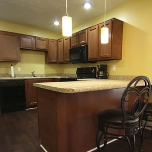 Kitchen with modern lighting and counter seating at Lakeside Landing Apartments in Lakeside Park, Kentucky