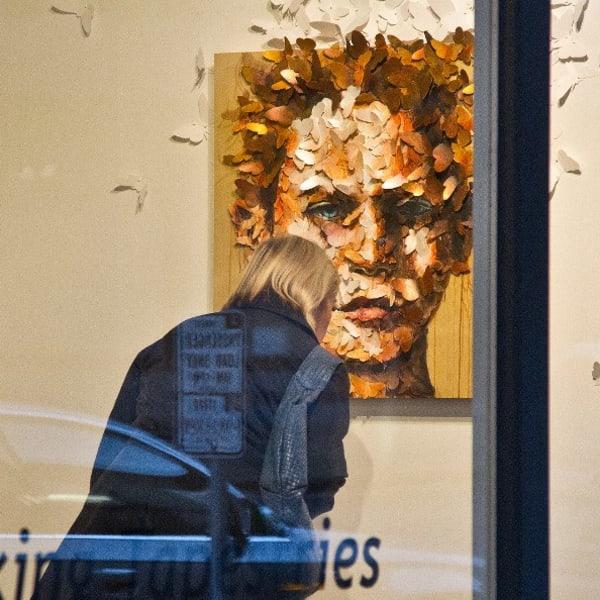 Resident enjoying art work near The Wave at Stadium Place in Seattle, Washington