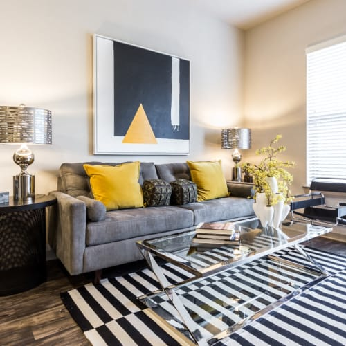 Bright and modern style living room with colorful décor at Marq Uptown in Austin, Texas