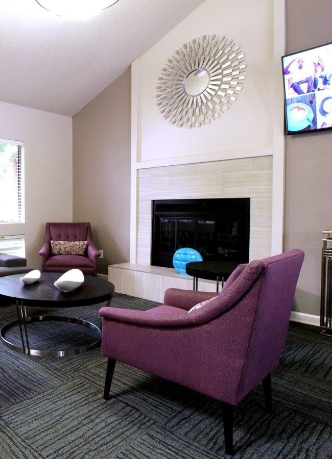 Clubhouse with a fireplace at Plum Tree Apartment Homes in Martinez, California
