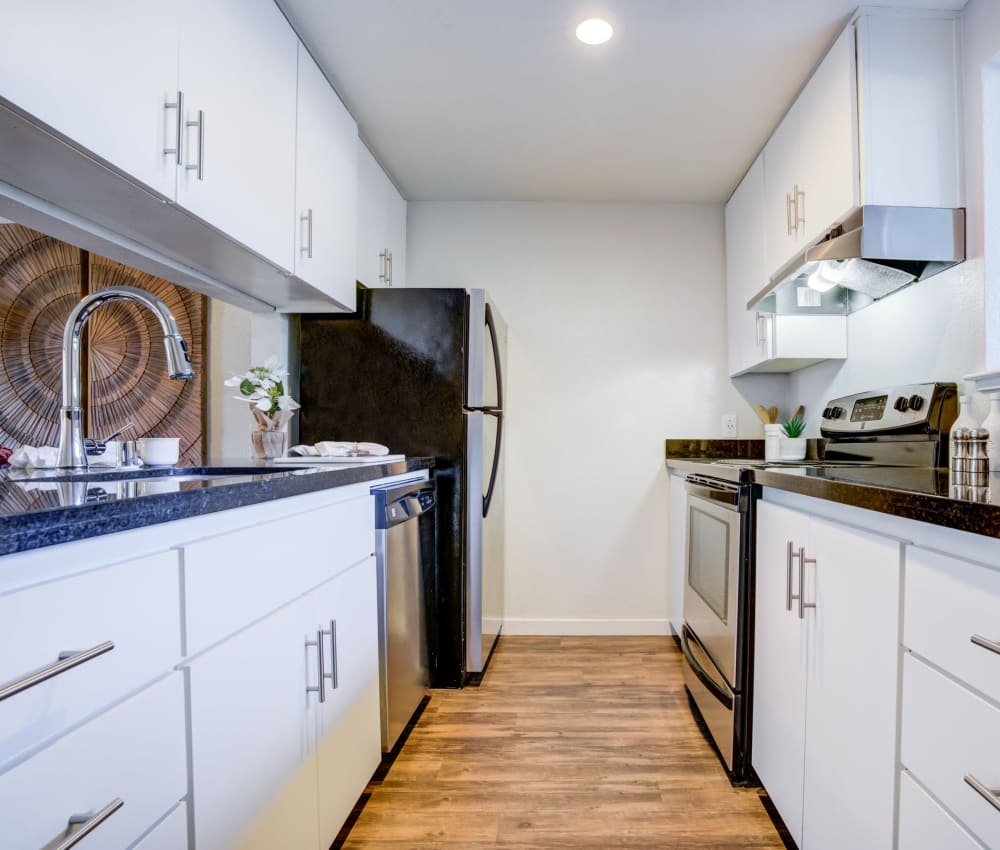 Kitchen with stainless-steel appliances in a model home at Haven Martinez in Martinez, California