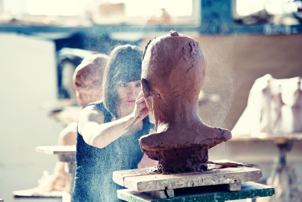 Resident sculpting clay at Telegraph Arts in Oakland, California