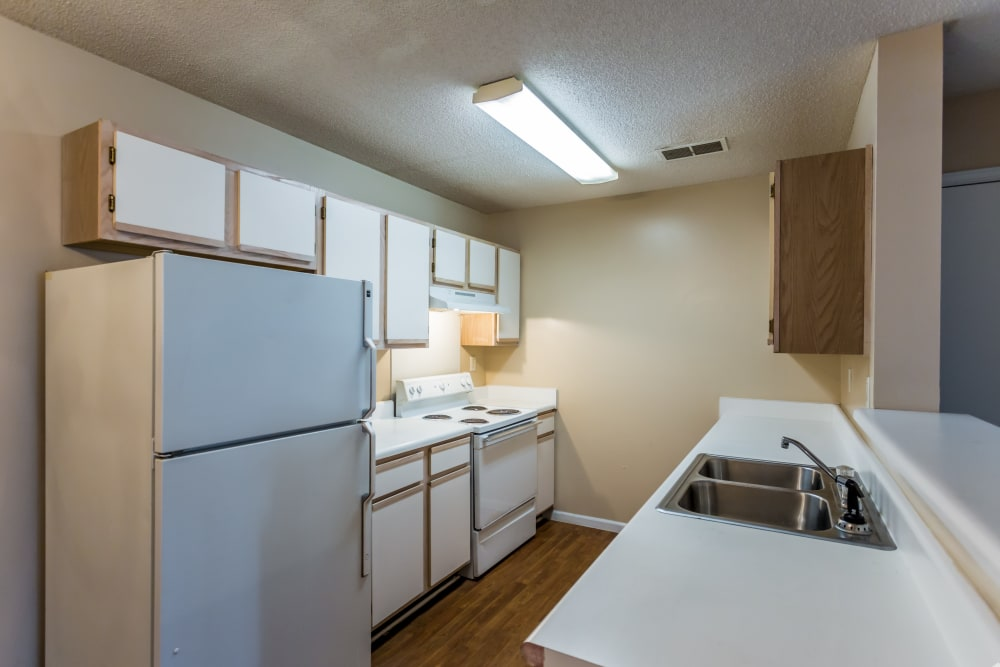 White appliances in an apartment kitchen at Park Ridge Apartments in Jackson, Tennessee