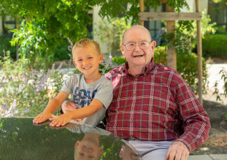 Happy resident with grandson at  senior living in Campbell