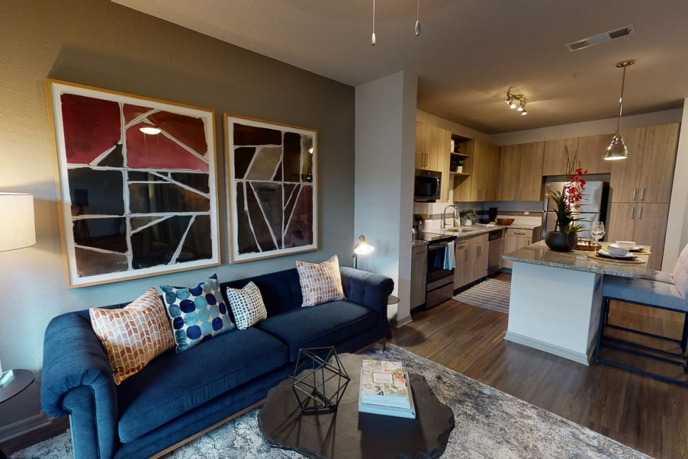 Model living room and kitchen with island at Integra 289 Exchange in DeBary, Florida