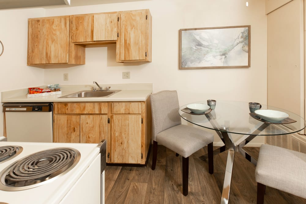 Dining room with wood-style flooring at Callaway Apartments in Taylorsville, Utah