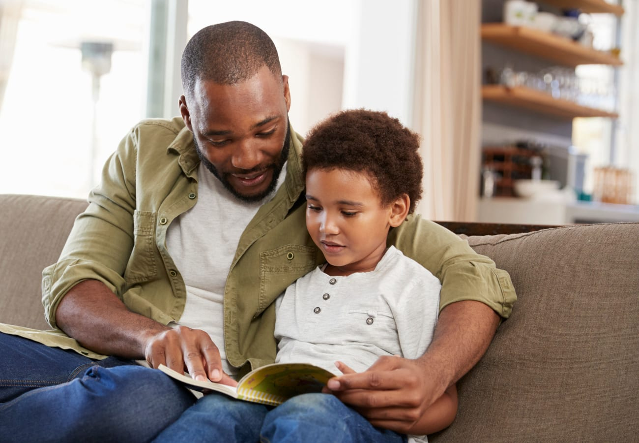 Father reading with his son at The Trails at Canyon Crest in Riverside, California