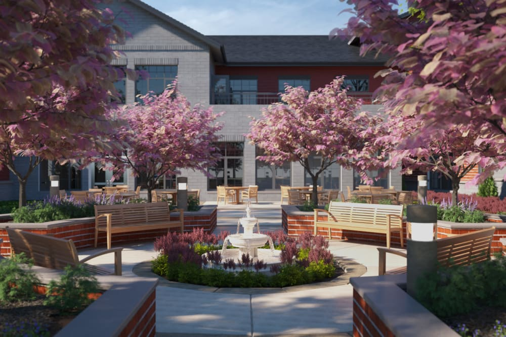 A rendering of the courtyard with a fountain and trees at Anthology of Midlothian in North Chesterfield, Virginia.