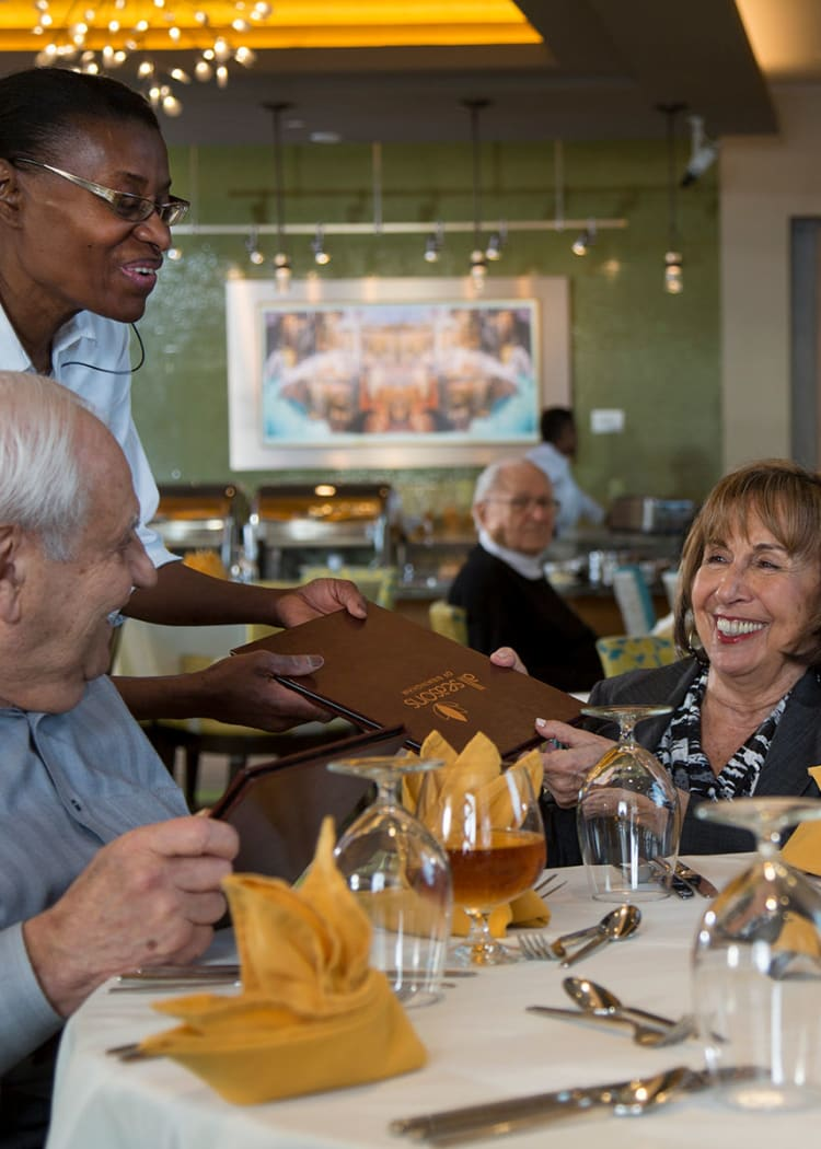 Residents completing their dinner order in one of our restaurant-style dining rooms at Casa Del Rio Senior Living in Peoria, Arizona