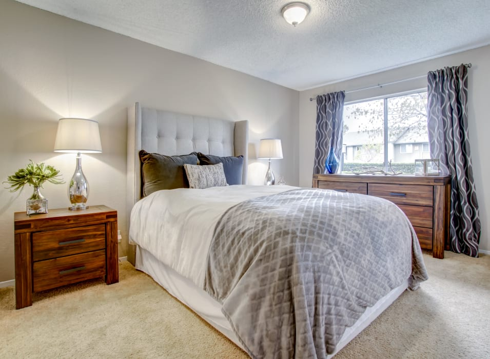 Well-furnished bedroom with plush carpeting in a model home at Vue Fremont in Fremont, California
