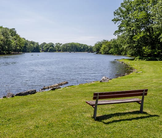 Lakeside bench at Green Lake Apartments & Townhomes in Orchard Park, New York