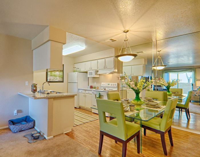 Beautiful dining room and kitchen at Granada Villas Apartment Homes in Lancaster, California