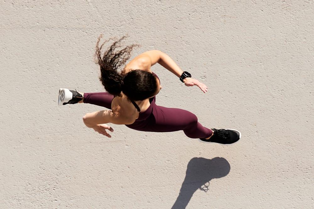 Resident running near K Street Flats Apartment Homes in Berkeley, California