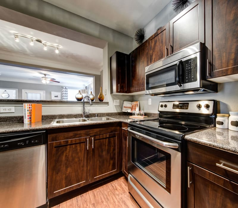 Kitchen with stainless steel appliances at Marquis on Gaston in Dallas, Texas