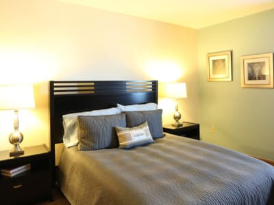 Well-lit bedroom at Gateway Lakes Apartments in Grove City, Ohio